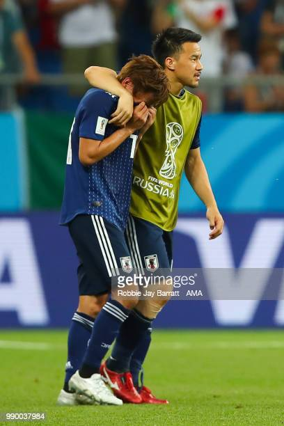 Shinji Okazaki of Japan consoles Takashi Inui of Japan at the end of the 2018 FIFA World Cup Russia Round of 16 match between Belgium and Japan at...