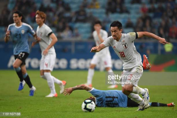 Shinji Okazaki of Japan dribbles the ball during the Copa America Brazil 2019 group C match between Uruguay and Japan at Arena do Gremio on June 20...
