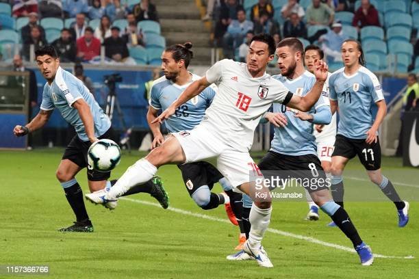 Shinji Okazaki of Japan in action during the Copa America Brazil 2019 group C match between Uruguay and Japan at Arena do Gremio on June 20 2019 in...