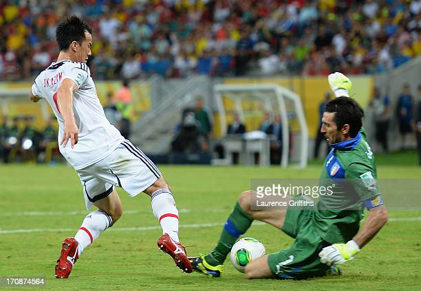 Shinji Okazaki of Japan is fouled in the penalty box by Gianluigi Buffon of Italy during the FIFA Confederations Cup Brazil 2013 Group A match...