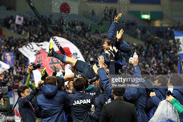 Shinji Okazaki of Japan is thrown into the air duirng a ceremony to mark his 100th international appearance after the FIFA World Cup Russia Asian...