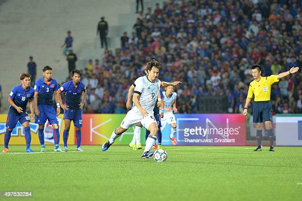 Shinji Okazaki of Japan kicks the ball during the 2018 FIFA World Cup Qualifier match between Cambodia and Japan on November 17 2015 in Phnom Penh...
