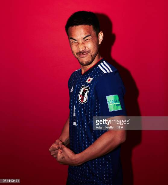 Shinji Okazaki of Japan poses for a portrait during the official FIFA World Cup 2018 portrait session at the FC Rubin Training Grounds on June 14...