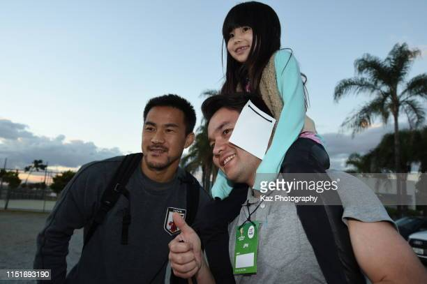 Shinji Okazaki of Japan poses for a selfie with Japanese Brasilians during the training session on June 22 2019 in Belo Horizonte Brazil