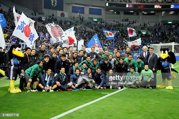 Shinji Okazaki of Japan poses for photographs with his team mates and national team staffs after a ceremony to mark his 100th international...
