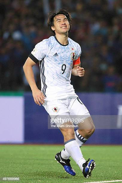 Shinji Okazaki of Japan reacts after missing a penalty during the 2018 FIFA World Cup Qualifier match between Cambodia and Japan at the National...