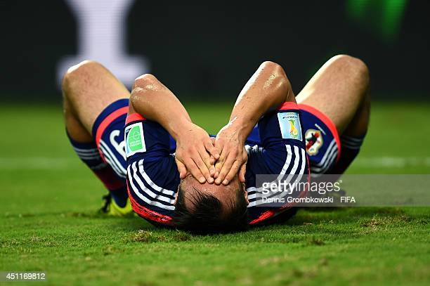 Shinji Okazaki of Japan reacts during the 2014 FIFA World Cup Brazil Group C match between Japan and Colombia at Arena Pantanal on June 24 2014 in...