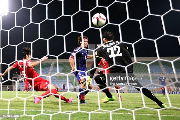 Shinji Okazaki of Japan scores his team's second goal during the 2018 FIFA World Cup Asian Group E qualifying match between Syria and Japan at Seeb...