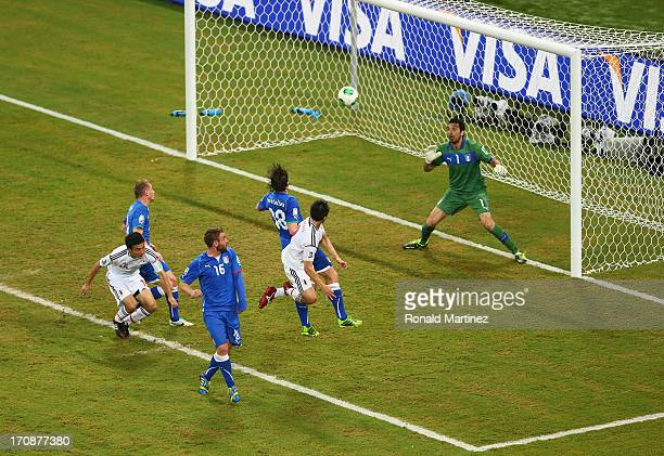 Shinji Okazaki of Japan scores his team's third goal to make the score 33 during the FIFA Confederations Cup Brazil 2013 Group A match between Italy...