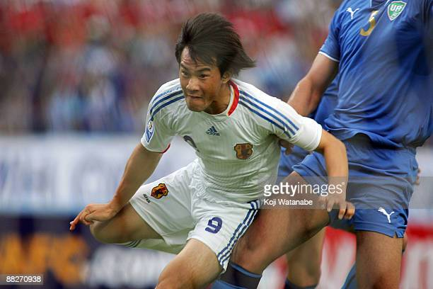 Shinji Okazaki of Japan scores the first goal during the 2010 FIFA World Cup qualifier match between Japan and Uzbekistan at Pakhtakor Markaziy...