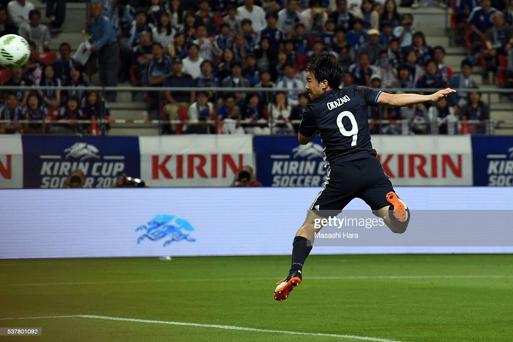 Shinji Okazaki #9 of Japan scores the first goal during the international friendly match between Japan and Bulgaria at the Toyota Stadium on June 3, 2016 in Toyota, Aichi, Japan.