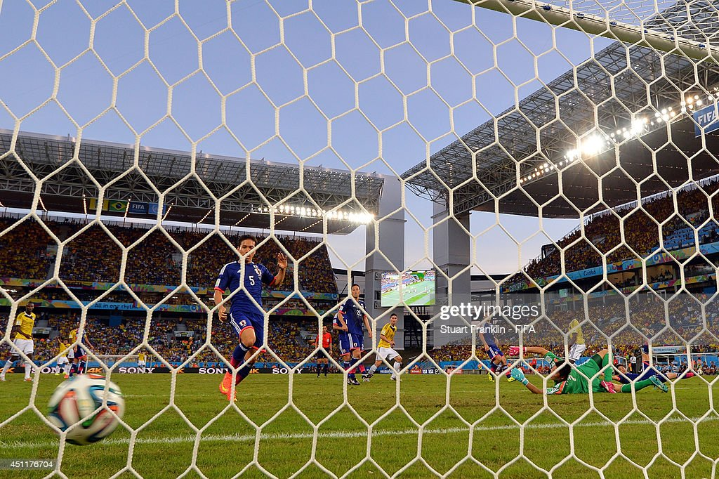 Shinji Okazaki of Japan scores the team's first goal during the 2014 FIFA World Cup Brazil Group C match between Japan and Colombia at Arena Pantanal on June 24, 2014 in Cuiaba, Brazil.
