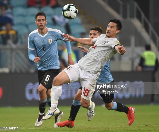 Shinji Okazaki of Japan shoots the ball during the Copa America Brazil 2019 group C match between Uruguay and Japan at Arena do Gremio on June 20...