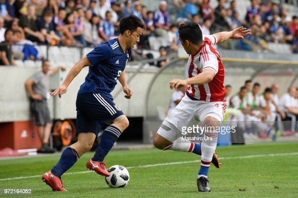 Shinji Okazaki of Japan takes on Fabian Balbuena of Paraguay during the international friendly match between Japan and Paraguay at Tivoli Stadion on...