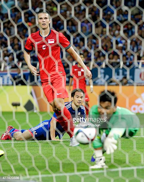 Shinji Okazaki of Japan watches the ball saved by Mohamad Izwan Bin Mahbud of Singapore during the 2018 FIFA World Cup Asian Qualifier second round...