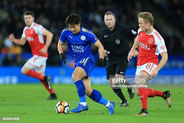 Shinji Okazaki of Leicester battles with Kyle Dempsey of Fleetwood during The Emirates FA Cup Third Round Replay match between Leicester City and...