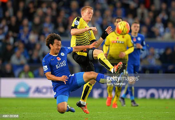 Shinji Okazaki of Leicester City and Ben Watson of Watford compete for the ball during the Barclays Premier League match between Leicester City and...
