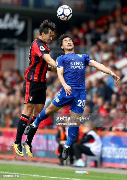 Shinji Okazaki of Leicester City and Charlie Daniels of AFC Bournemouth compete for the ball during the Premier League match between AFC Bournemouth...