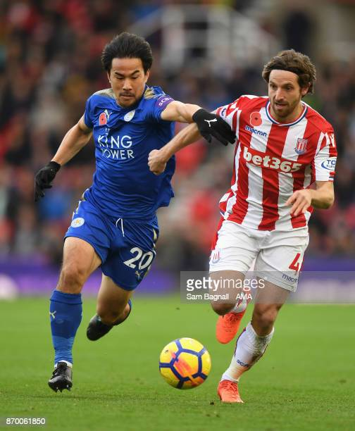 Shinji Okazaki of Leicester City and Joe Allen of Stoke City during the Premier League match between Stoke City and Leicester City at Bet365 Stadium...