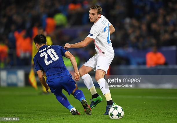 Shinji Okazaki of Leicester City and Laurens De Bock of Club Brugge battle for possession during the UEFA Champions League Group G match between...