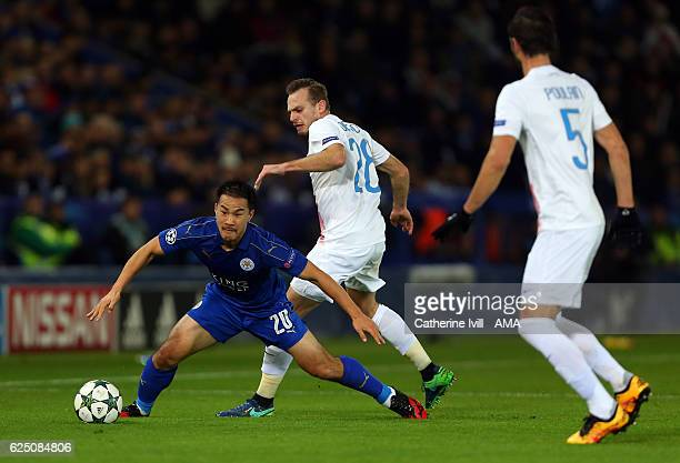Shinji Okazaki of Leicester City and Laurens De Bock of Club Brugge during the UEFA Champions League match between Leicester City FC and Club Brugge...