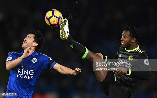 Shinji Okazaki of Leicester City and Michy Batshuayi of Chelsea battle for the ball during the Premier League match between Leicester City and...