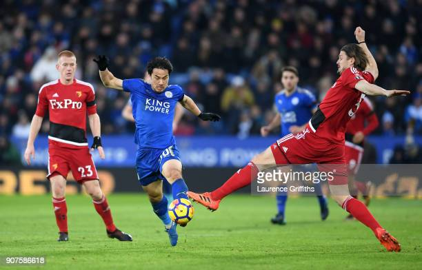 Shinji Okazaki of Leicester City and Sebastian Prodl of Watford battle for possesion during the Premier League match between Leicester City and...