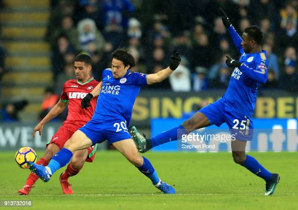 Shinji Okazaki of Leicester City and Wilfred Ndidi chase the ball during the Premier League match between Leicester City and Swansea City at The King...