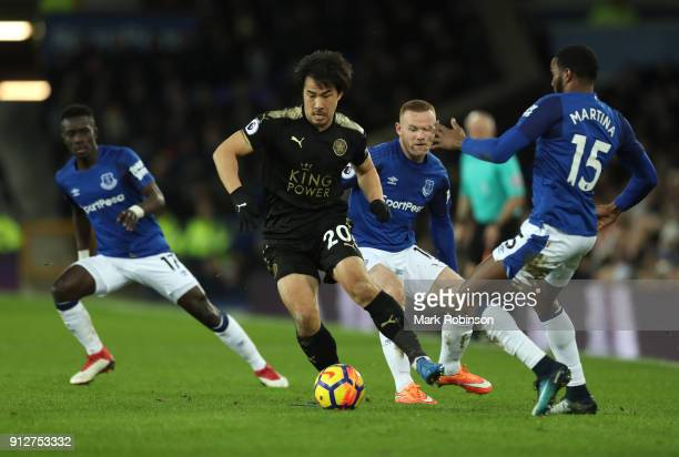 Shinji Okazaki of Leicester City attempts to get past Cuco Martina of Everton during the Premier League match between Everton and Leicester City at...