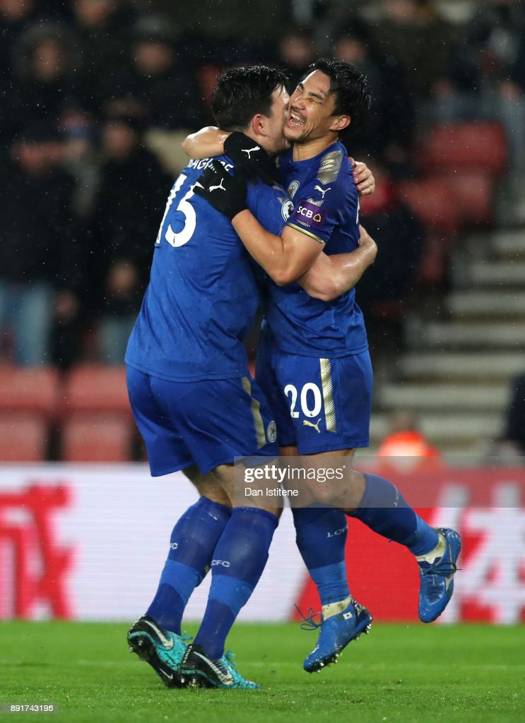 Shinji Okazaki of Leicester City celebrates after scoring his sides second goal with Harry Maguire of Leicester City during the Premier League match between Southampton and Leicester City at St Mary's Stadium on December 13, 2017 in Southampton, England.