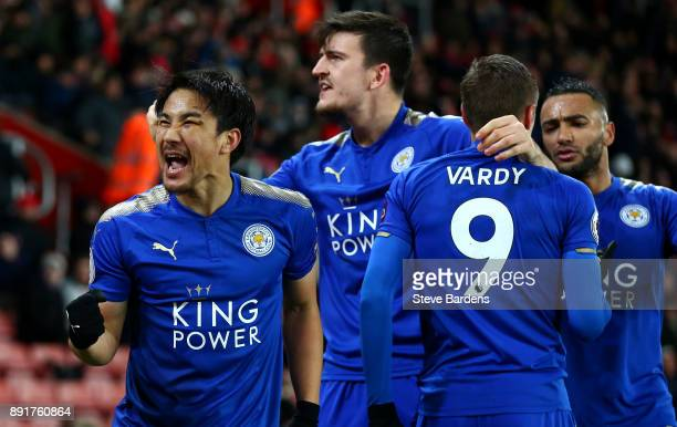 Shinji Okazaki of Leicester City celebrates after scoring his sides fourth goal with his Leicester City team mates during the Premier League match...