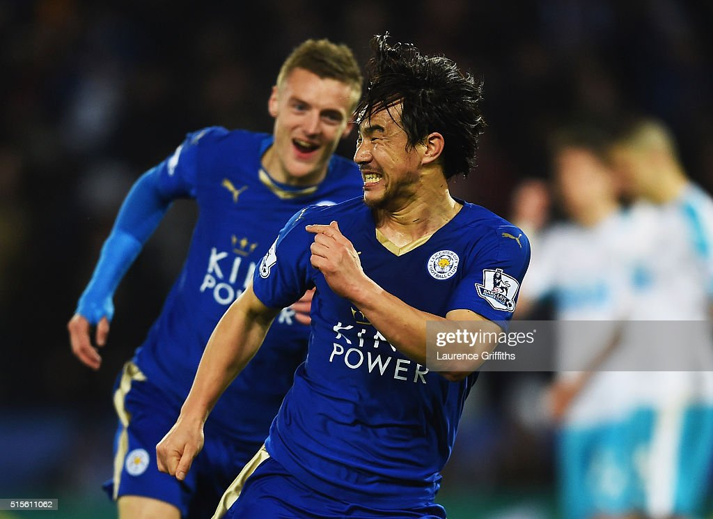 Shinji Okazaki of Leicester City (front) celebrates as he scores their first goal with an overhead kick during the Barclays Premier League match between Leicester City and Newcastle United at The King Power Stadium on March 14, 2016 in Leicester, England.