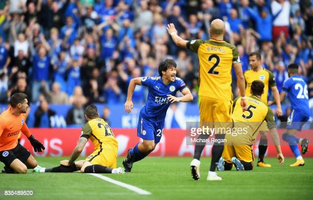 Shinji Okazaki of Leicester City celebrates scoring his sides first goal during the Premier League match between Leicester City and Brighton and Hove...
