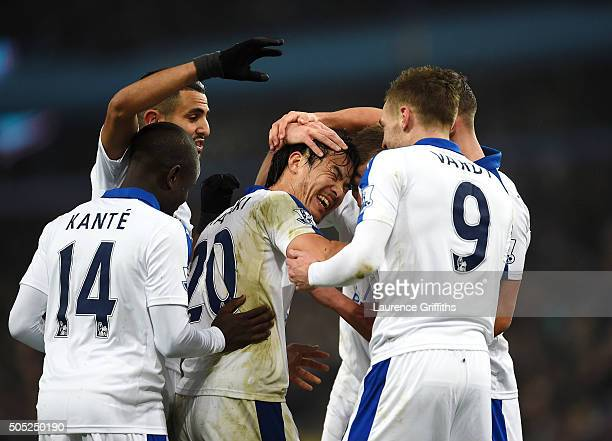 Shinji Okazaki of Leicester City celebrates scoring his team's first goal with his team mates during the Barclays Premier League match between Aston...