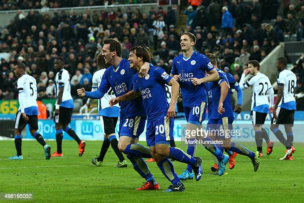 Shinji Okazaki of Leicester City celebrates scoring his team's third goal with his team mates during the Barclays Premier League match between...