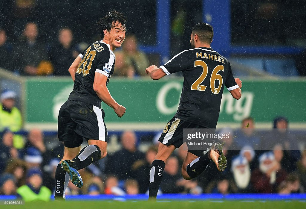 Shinji Okazaki (L) of Leicester City celebrates scoring his team's third goal with his team mate Riyad Mahrez (R)during the Barclays Premier League match between Everton and Leicester City at Goodison Park on December 19, 2015 in Liverpool, England.