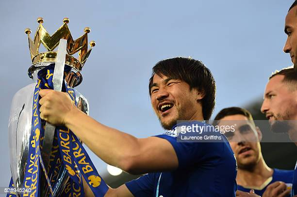 Shinji Okazaki of Leicester City celebrates the season champions with the Premier League Trophy after the Barclays Premier League match between...
