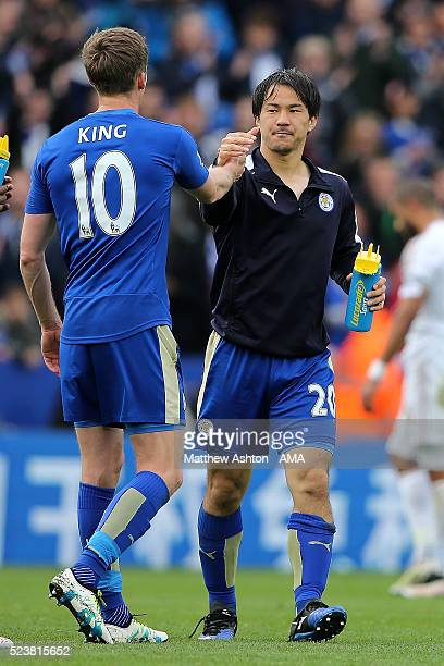 Shinji Okazaki of Leicester City celebrates with Andy King at the end of the Barclays Premier League match between Leicester City and Swansea City at...