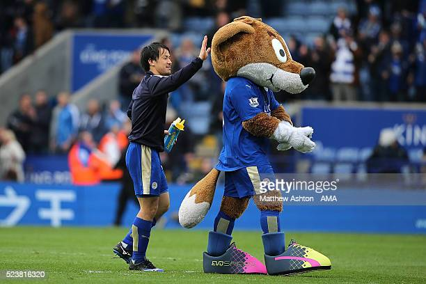 Shinji Okazaki of Leicester City celebrates with club mascot Filbert the Fox at the end of the Barclays Premier League match between Leicester City...
