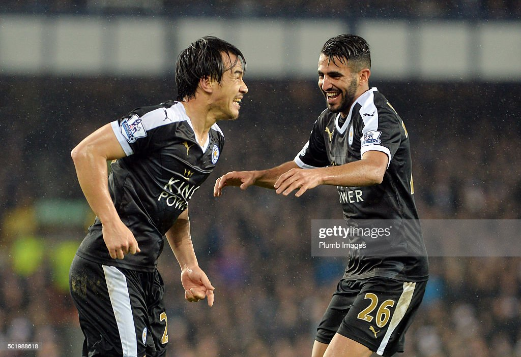Shinji Okazaki of Leicester City celebrates with Riyad Mahrez of Leicester City after scoring to make it 2-3 during the Premier League match between Everton and Leicester City at Goodison Park Stadium on December 19, 2015 in Liverpool , United Kingdom.
