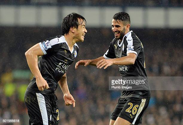 Shinji Okazaki of Leicester City celebrates with Riyad Mahrez of Leicester City after scoring to make it 2-3 during the Premier League match between...