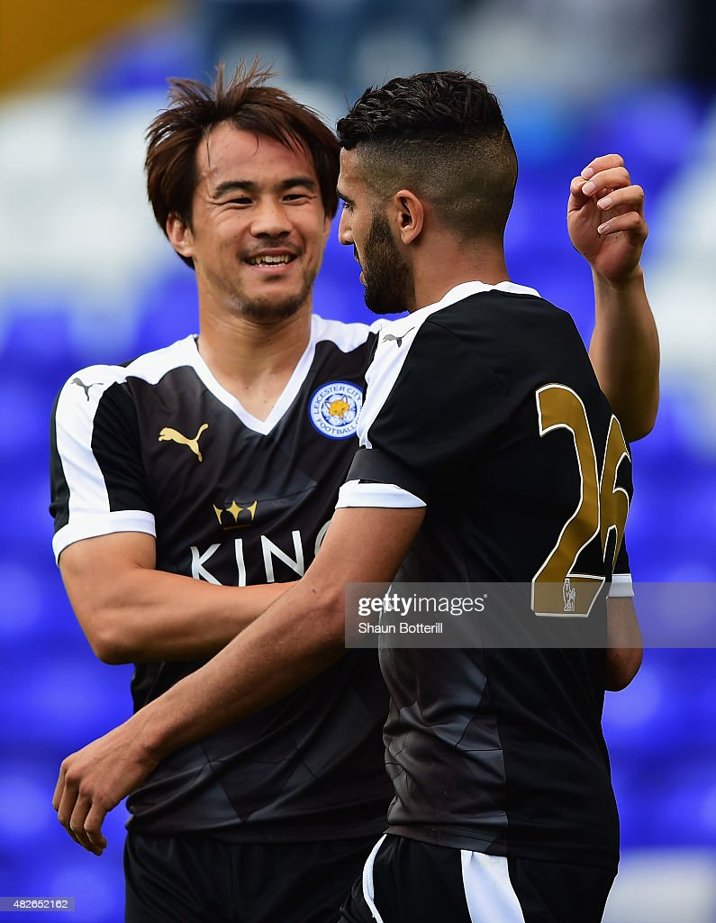 Shinji Okazaki of Leicester City celebrates with team-mate Riyad Mahrez after scoring during the Pre-Season Friendly match between Birmingham City and Leicester City at St Andrews (stadium) on August 1, 2015 in Birmingham, England.