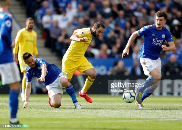 Shinji Okazaki of Leicester City challenges Gonzalo Higuain of Chelsea during the Premier League match between Leicester City and Chelsea FC at The...