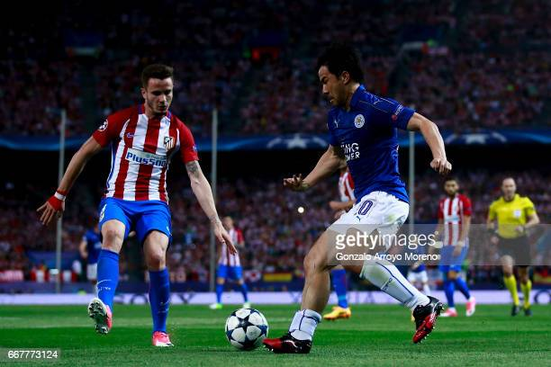 Shinji Okazaki of Leicester City FC competes for the ball with Saul Niguez of Atletico de Madrid during the UEFA Champions League Quarter Final first...
