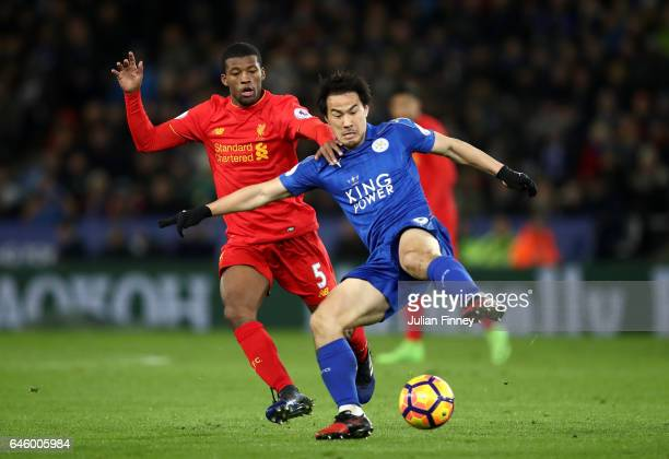 Shinji Okazaki of Leicester City holds off Georginio Wijnaldum of Liverpool during the Premier League match between Leicester City and Liverpool at...