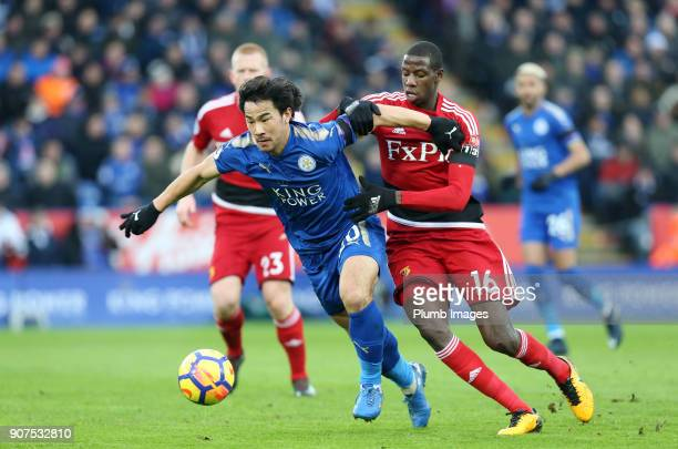 Shinji Okazaki of Leicester City in action with Abdoulaye Doucoure of Watford during the Premier League match between Leicester City and Watford at...