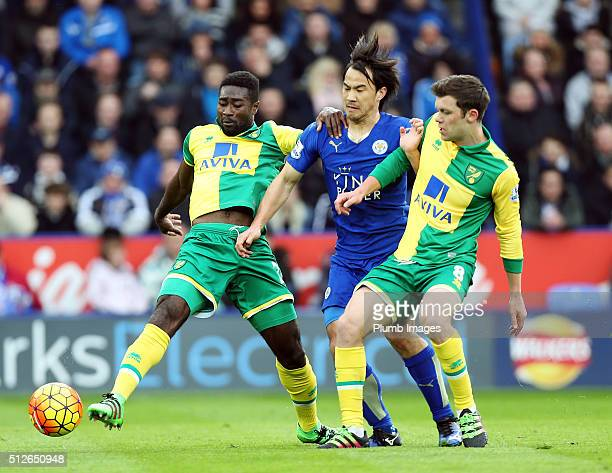 Shinji Okazaki of Leicester City in action with Alex Tetty and Jonny Howson of Norwich City during the Barclays Premier League match between...