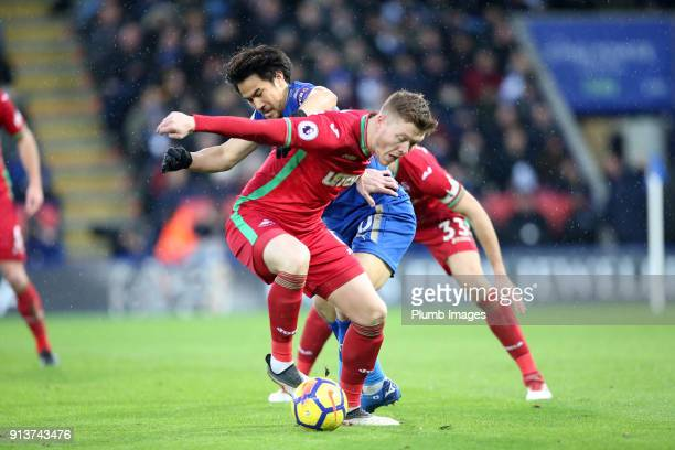Shinji Okazaki of Leicester City in action with Alfie Mawson of Swansea City during the Premier League match between Leicester City and Swansea City...