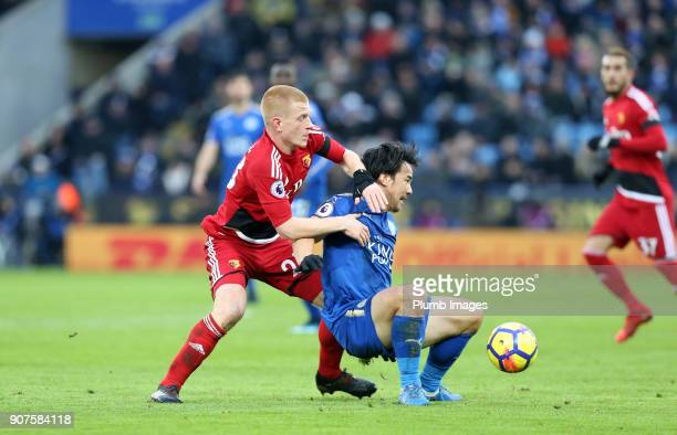 Shinji Okazaki of Leicester City in action with Ben Watson of Watford during the Premier League match between Leicester City and Watford at King...