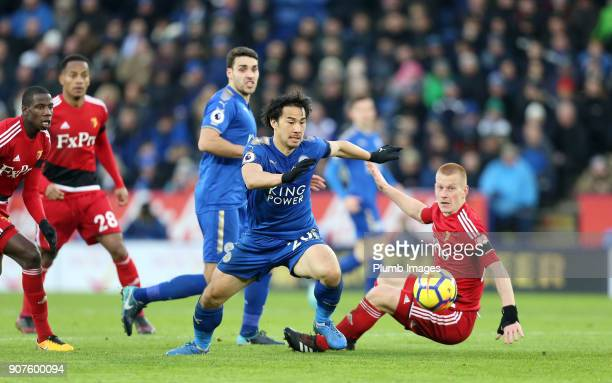 Shinji Okazaki of Leicester City in action with Ben Watson of Watford during the Premier League match between Leicester City and Watford at The King...
